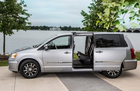 Driver angle of a white 2016 Chrysler Town & Country with its side doors open