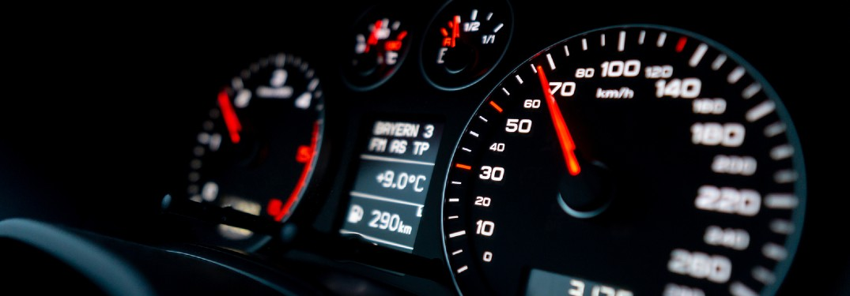 Close up of a speedometer inside a car