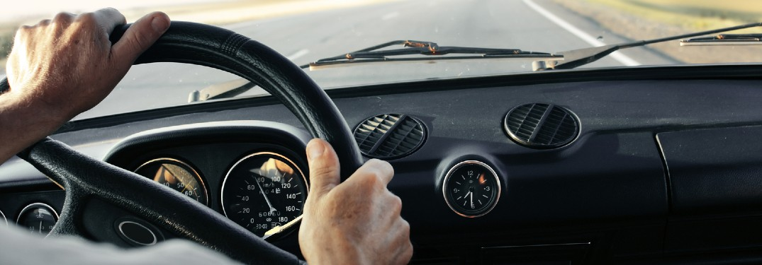 Person's hands on a steering wheel
