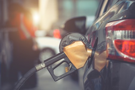 Gas being pumped into a vehicle