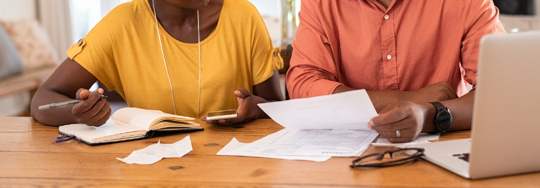 Close up of a couple looking at their finances