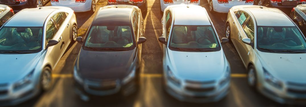 Four vehicles on a used car lot