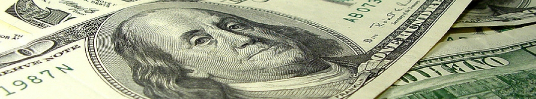 Money closeup with a hundred dollar bill at the center