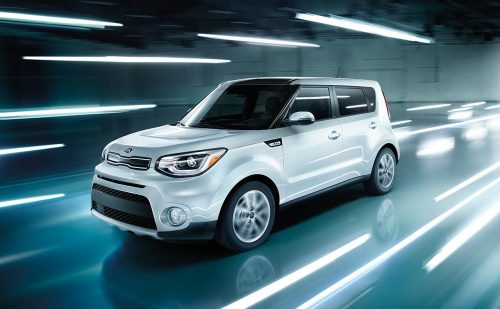 2018 Kia Soul driving in a blue tunnel with white lights