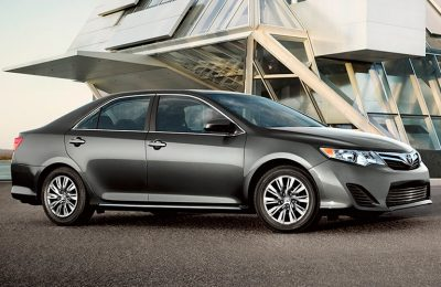 2014 Toyota Camry parked outside of a modern looking building