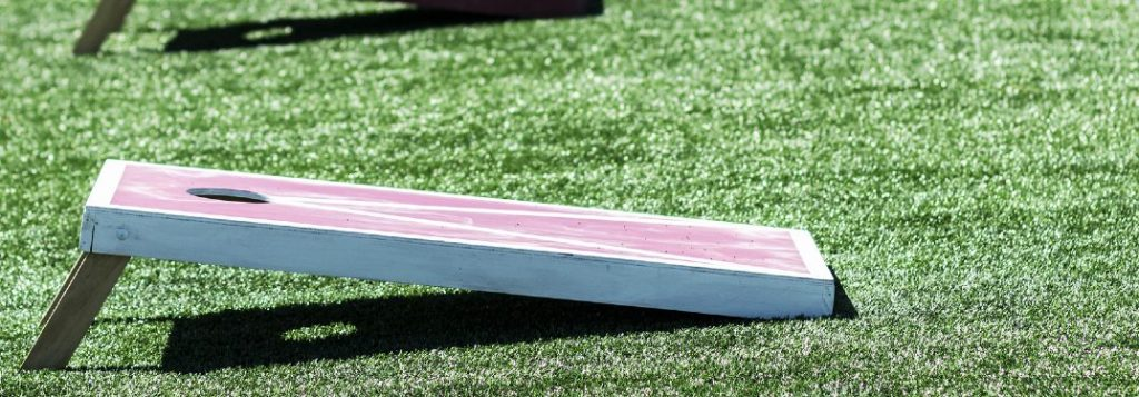 Cornhole board set up on grass