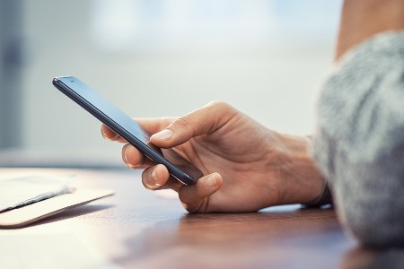 Close up of a person holding a smartphone
