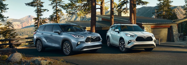 A blue 2020 Toyota Highlander parked next to a white 2020 Toyota Highlander