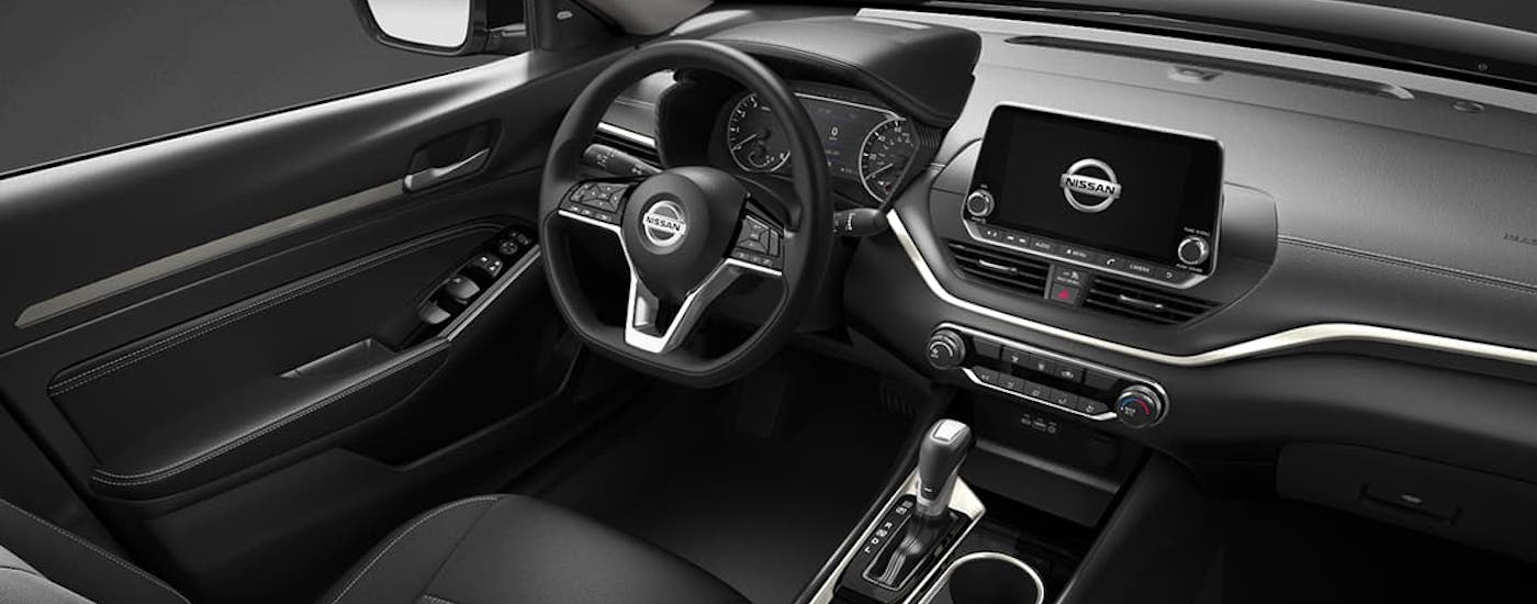 The black interior of a 2021 Nissan Altima is shown.