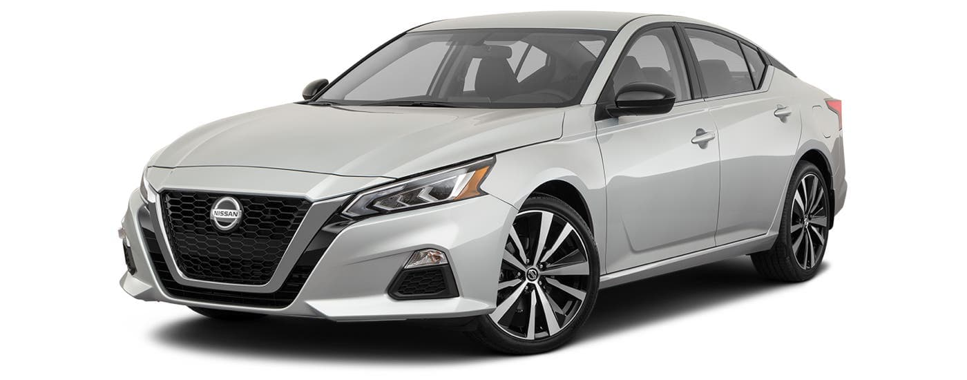 A white 2021 Nissan Altima SR is angled left.