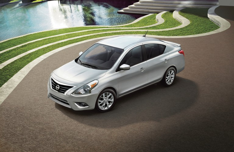 Front driver angle of a silver 2019 Nissan Versa parked outdoors
