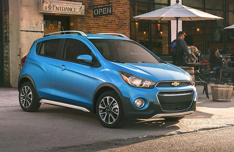 Front passenger angle of a blue 2019 Chevrolet Spark