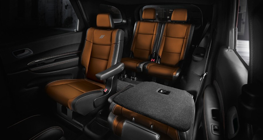Rear seats inside the 2020 Dodge Durango with one of the Captain's Chairs folded
