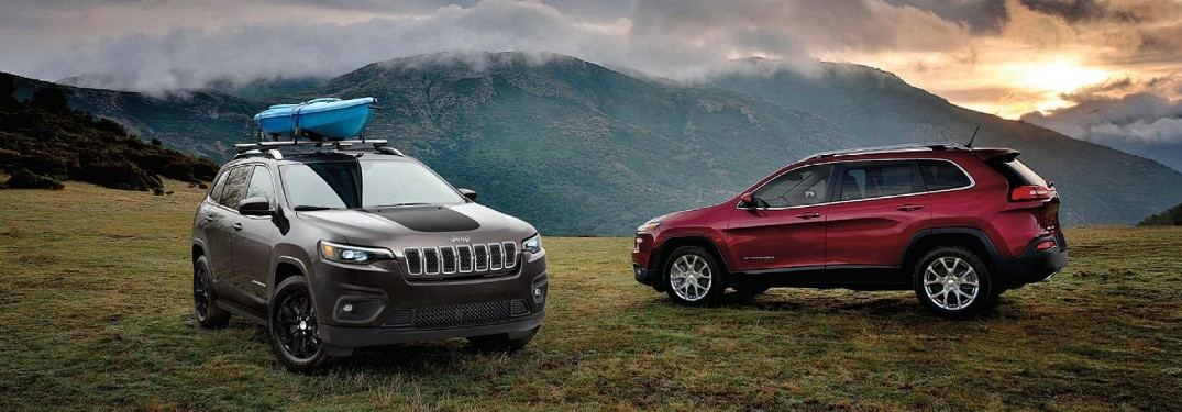 Front passenger angle of a grey 2020 Jeep Cherokee parked outdoors near a red 2020 Jeep Cherokee
