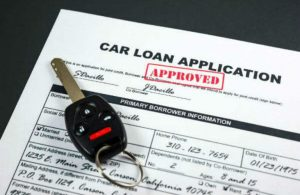 Car Loan application with a key on it