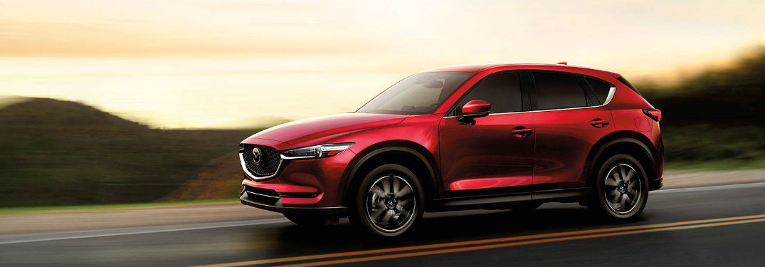 Mazda CX-5 driving on a road