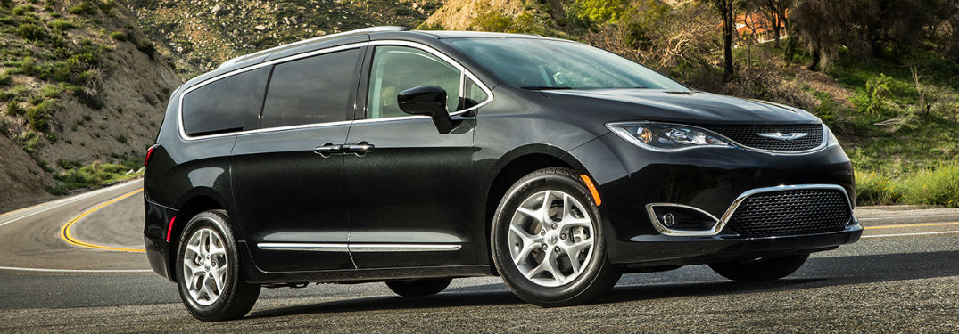 Chrysler Pacifica driving on a road