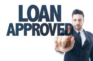 Loan approved text with man in the background