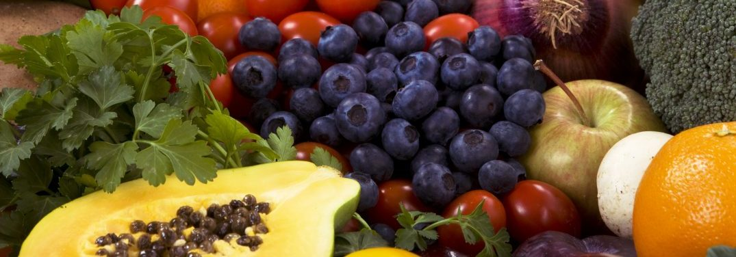 Healthy organic vegetables and fruits as background