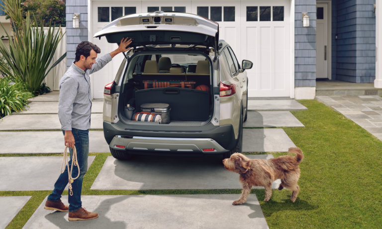 2021 Nissan Rogue exterior rear cargo open with dog