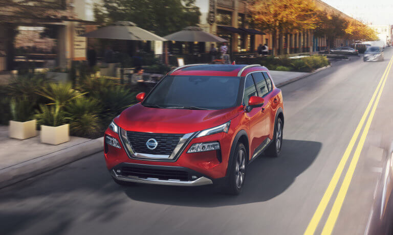 2021 Nissan Rogue exterior driving down city street