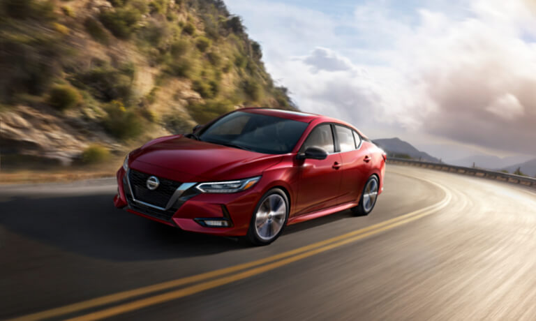 2020 Nissan Sentra exterior driving on mountain road in turn