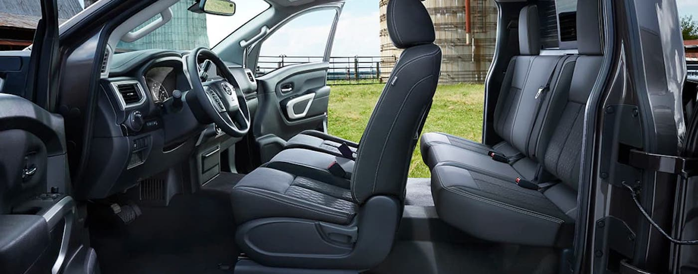 The two rows of seats in a 2021 Nissan Titan are shown from the side.