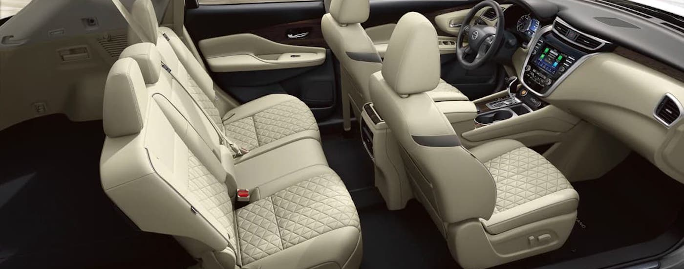 The front two rows of cream-colored seats are shown in a 2021 Nissan Murano from a high angle.