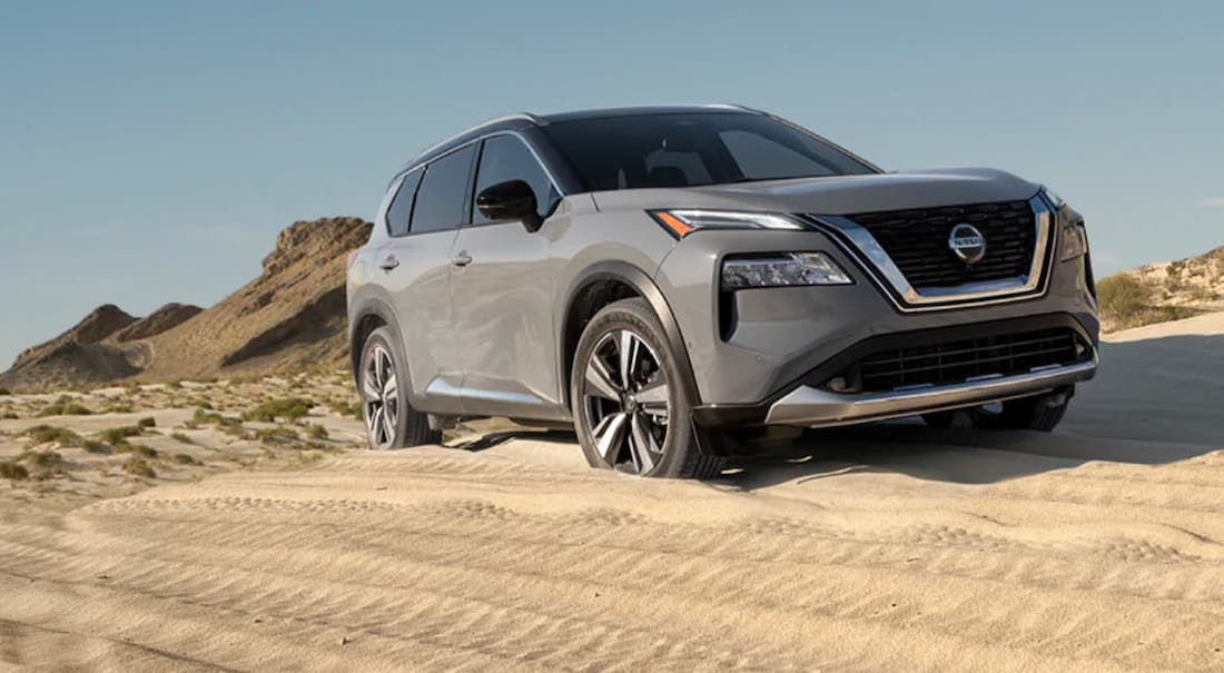 A gray 2021 Nissan Rogue is driving on a sand dune after leaving Nashville Nissan dealer.