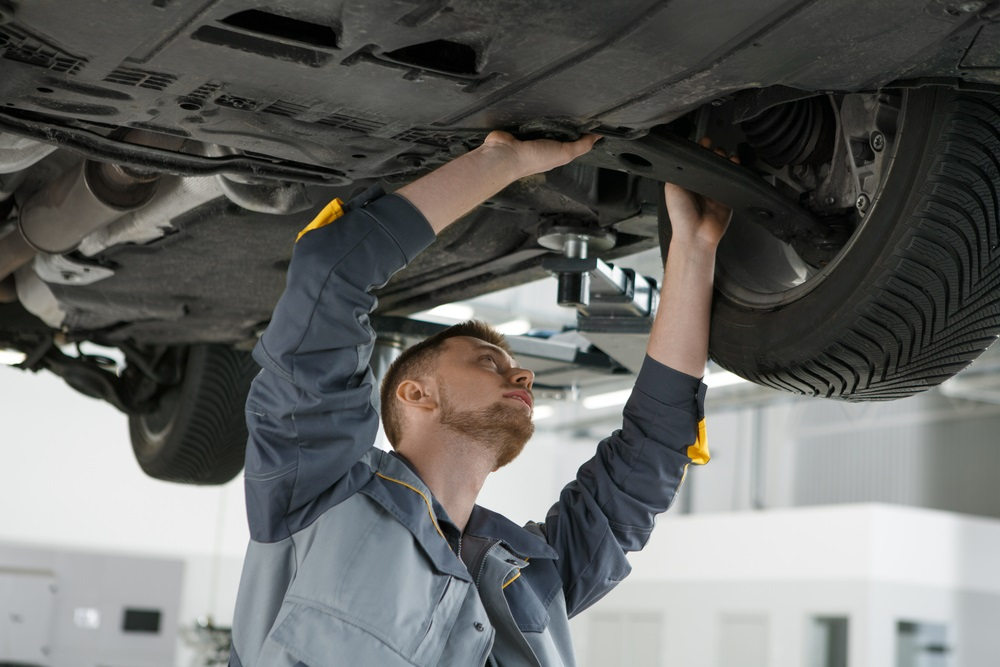 Certified Automotive Technician working on Vehicle