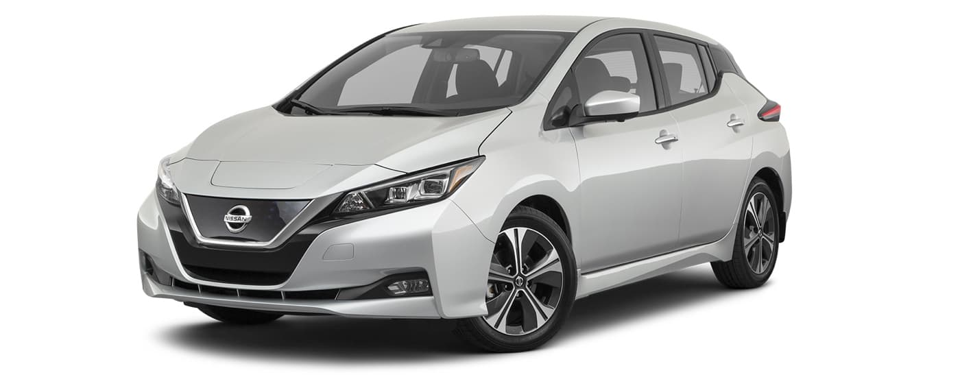 A white 2021 Nissan LEAF is angled left.