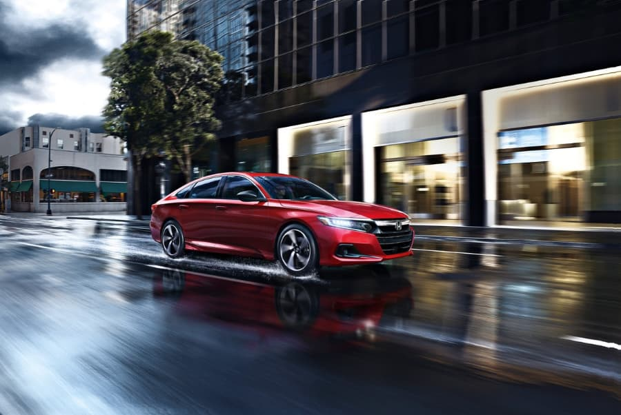 2021 Red Honda Accord Sport Driving on Wet Road