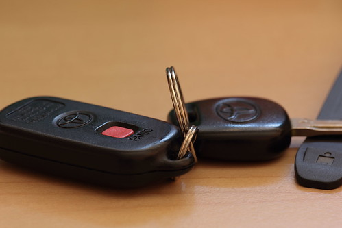 A set of Toyota keys laying on a table.