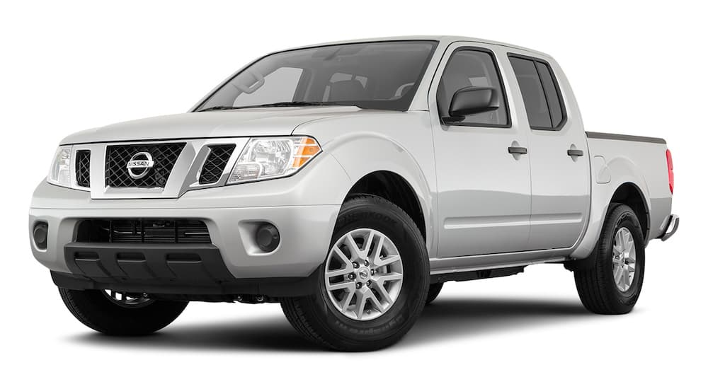 A silver 2021 Nissan Frontier is angled left.