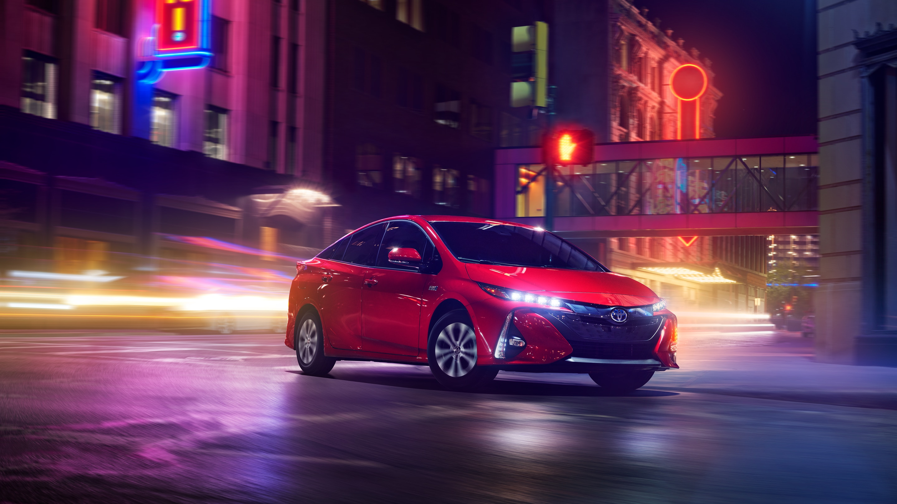 The new 2021 Toyota Corolla Hybrid in a colorful neon street setting.