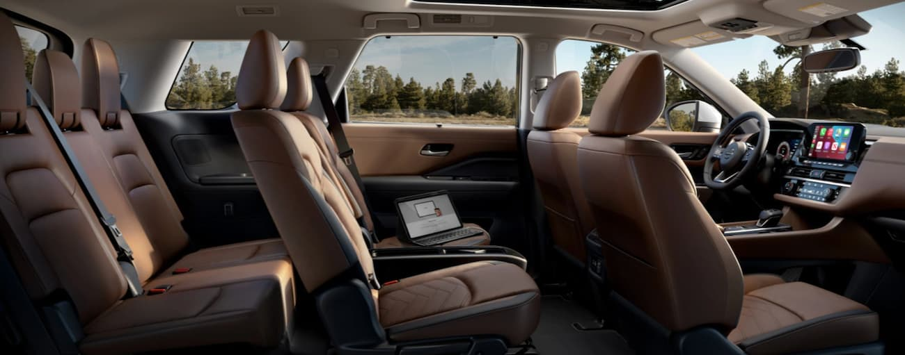 The brown interior in a 2022 Nissan Pathfinder is shown from the side.
