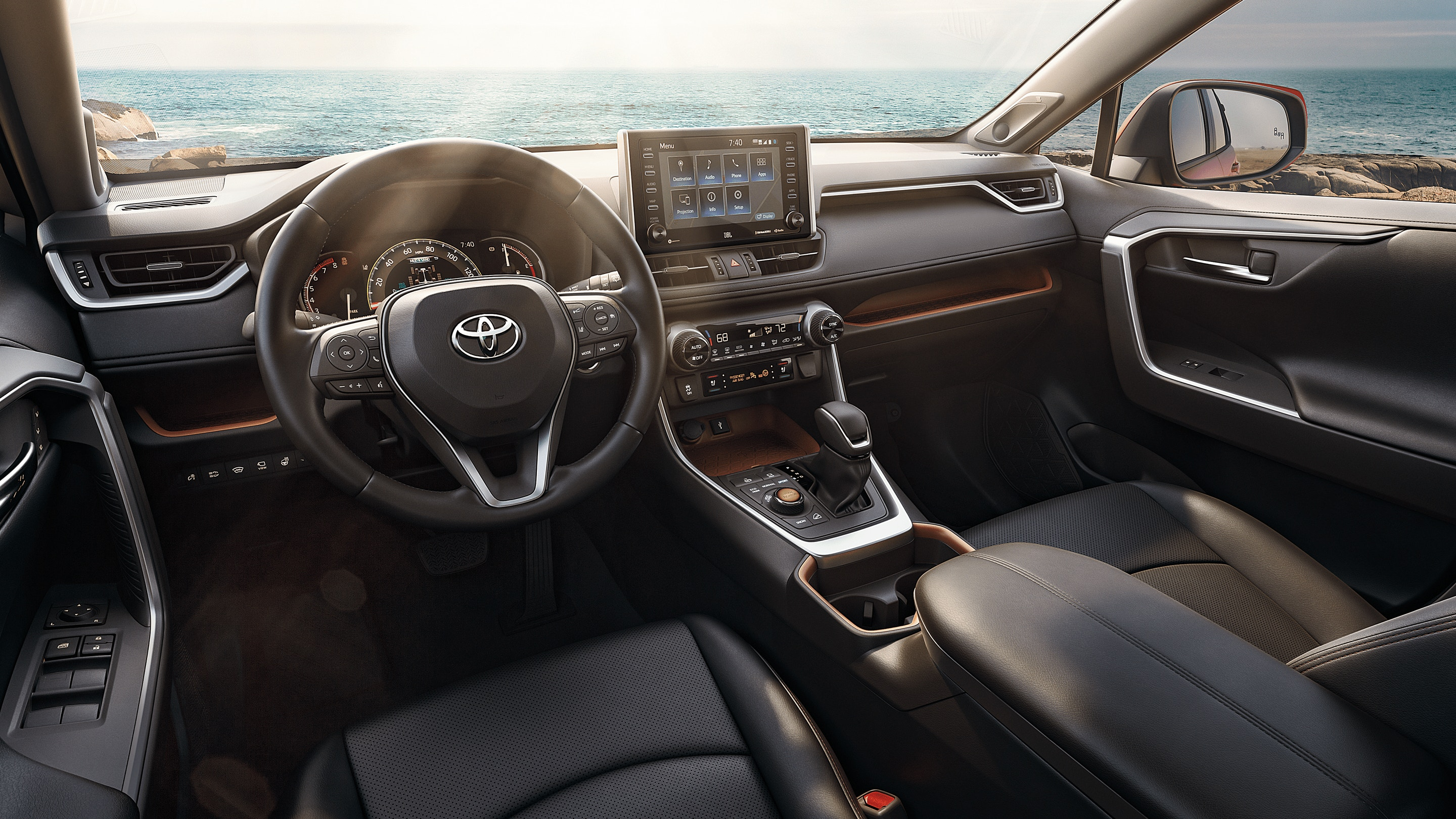 A picture from the inside of the 2021 Toyota RAV4, parked on top of a mountain rest point.