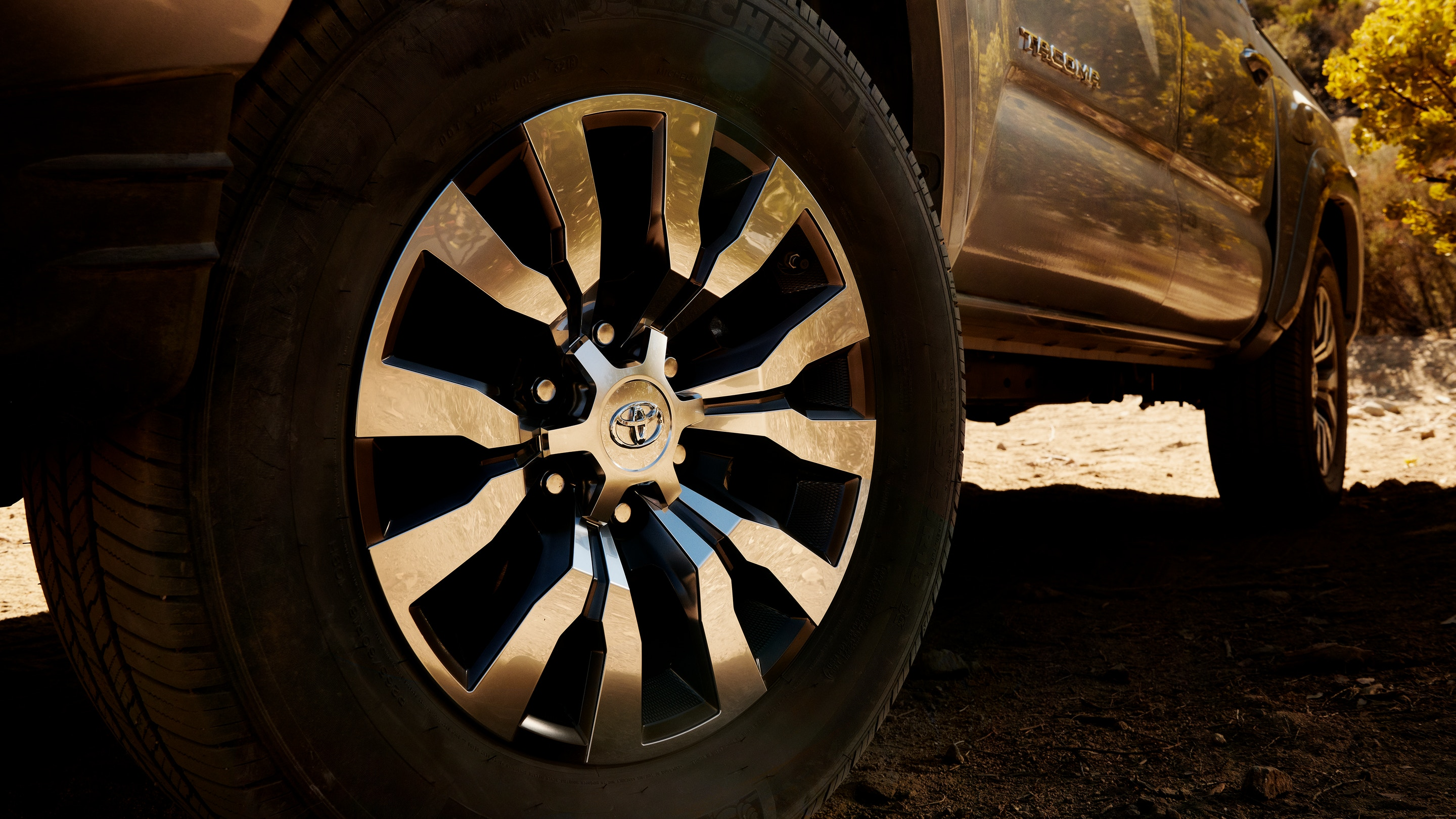 A close-up picture of the wheel and brakes to a silver 2021 Toyota Tacoma.