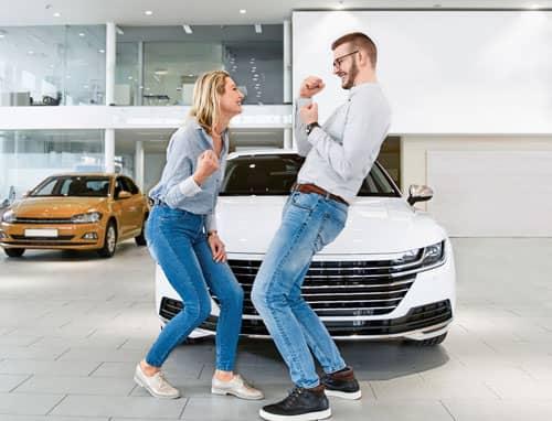 happy couple buying car
