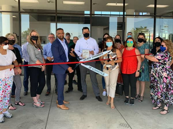 group of people cutting ribbon with big scissors 2