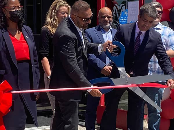 group of people cutting ribbon with big scissors 3