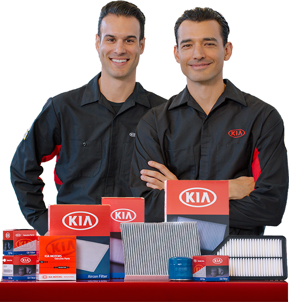 Two mechanics in front of parts.