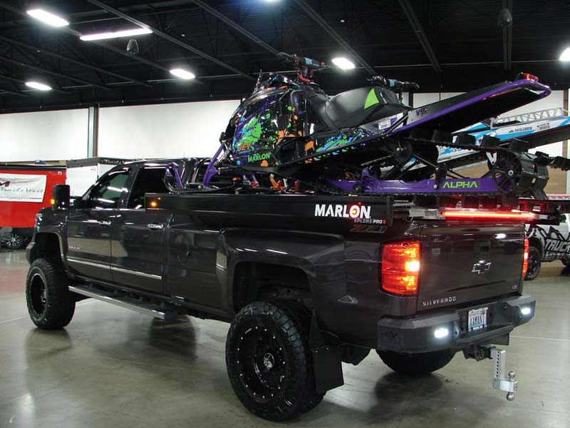 Snowmobile in bed of truck