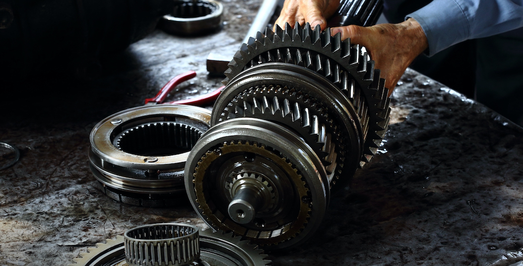 Technicians Handling Transmission Repair